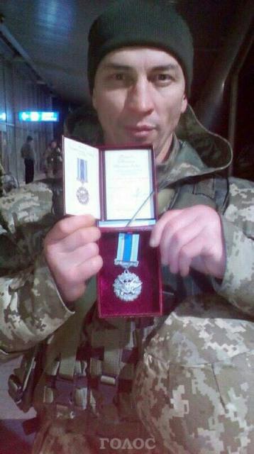 комов медаль